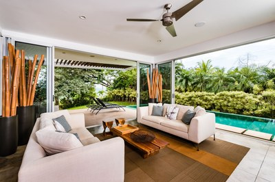Living Room with Pool and Tropical Forest View - Modern Ocean View Luxury Residences for Sale Costa Rica