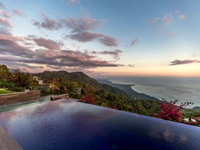Bouganvileas to Ocean view dawn at Hilltop House for Sale in Puntarenas, Costa Rica