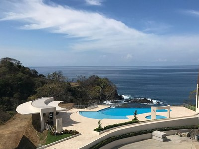 Infinity ocean view pool in luxury community with condos for sale
