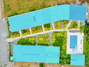 Basically rectangular with buildings along perimeter, paths and pool