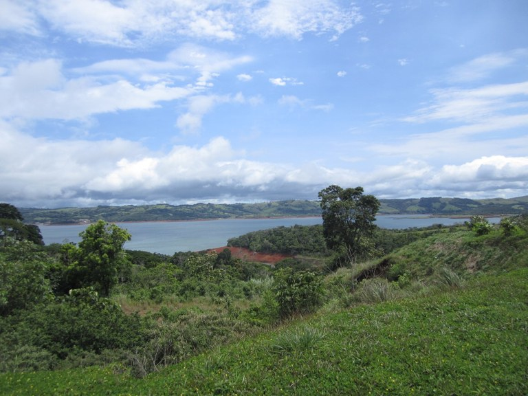 1.5 Acre Lake Arenal View Lot With Stream: Safe, Secure Development With Boat Ramp and Docking Facility