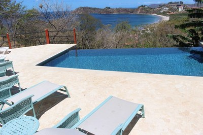 Pool Area of Casa Mega Flamingo Beach Rental Community Infinity Pool