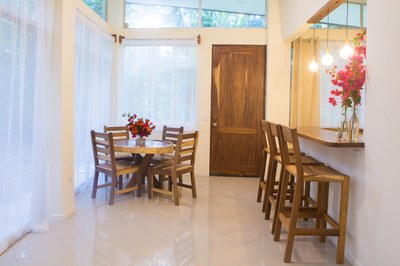 Living to Dining Area of Guana II- 2 Bedroom Modern Home 5 min walk to beach