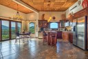 Open Kitchen and Dining Area of This Panoramic Ocean View Penthouse Condominium