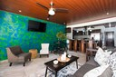 Living Area and Open Kitchen of This Modern Ocean View Condominium at the Heart of Flamingo
