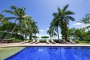 Pool and Lounging Areaof This Ocean View Condominium with Private Veranda