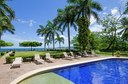 Pool and Lounging Area of This Ocean View Condominium with Private Veranda