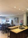 Living Area and Open Kitchen of This Well Equipped Ocean View Condo