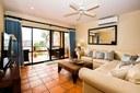 Living Area of Elegant 3 Bedroom Oceanfront Condo wit Balcony
