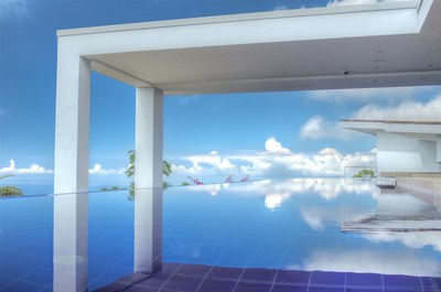 Pool with an ocean view surrounded by mountains in Bahia Ballena, Costa Rica, Houses for sale