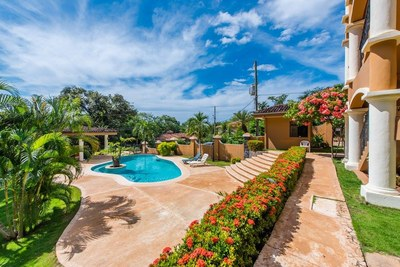 14 - Calm and beautiful community pool - Ocean-vicinity Luxury Condo For Sale.jpg
