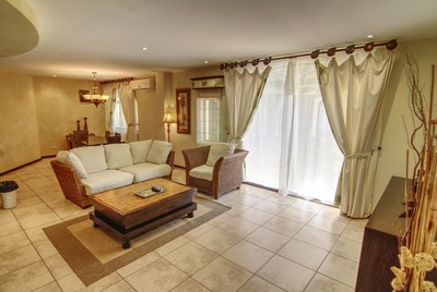 Living room_entertainment space - Luxury Condo Close To Tamarindo Beach