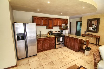 Spacious Kitchen With Double Sink And Breakfast Bar - Luxury Condo Close To Tamarindo Beach