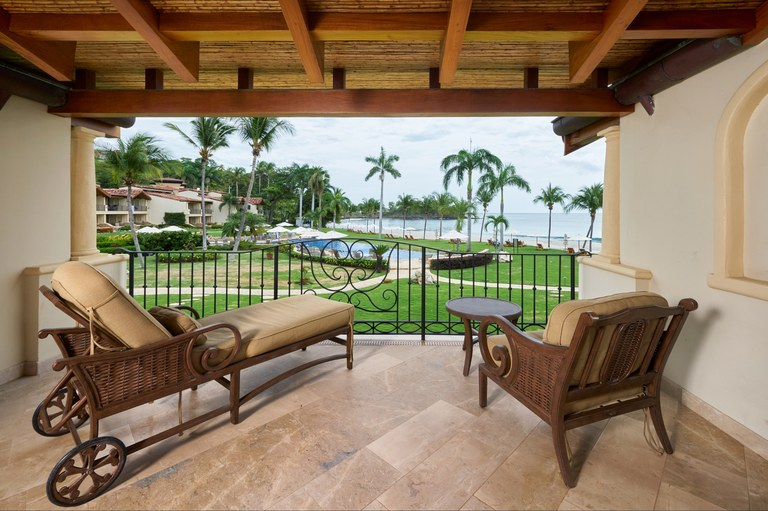 Villa de la Playa: spacious two-bedroom ocean front condominium set on a rare white sand beach!