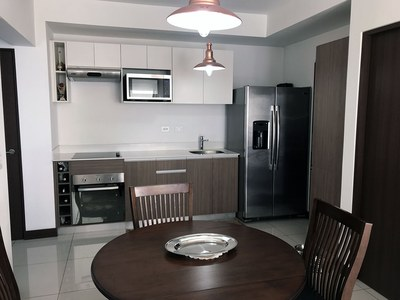 Dinning Kitchen view of Nunciatura Flats.jpg