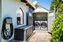 Outdoor Laundry & Storage_High-End Whirlpool High Capacity Washer & Dryer.  New Weber Grill (not in Pic)